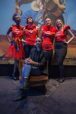 Designer Jenny Skavlan surrounded by employees of The Thief dressed in customized Principle 6 outfits