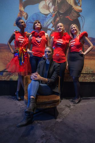 Designer Jenny Skavlan surrounded by employees of The Thief dressed in customized Principle 6 outfits ...