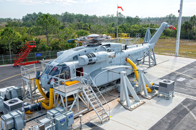 In January 2014, Sikorsky powered 'on' the three GE 7,500 shaft horsepower class engines of the first CH-53K heavy lift helicopter prototype - known as the Ground Test Vehicle - and spun the rotor head without rotor blades. The event continues safety-of-flight tests started in December with pilots at the aircraft's controls. The Ground Test Vehicle is anchored to the ground at Sikorsky's West Palm Beach, Development Flight Center in Florida. Four additional test aircraft are being prepared for flight test, beginning in late 2014.  (PRNewsFoto/Sikorsky Aircraft Corporation)