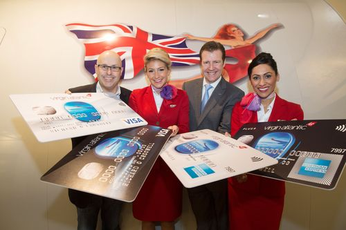 Alan Lias, head of Loyalty and Ancillary Revenue Development at Virgin Atlantic (left) and Michael Donald, Marketing and Commercial executive for MBNA join Virgin Atlantic cabin crew to celebrate the launch of the new partnership. (PRNewsFoto/MBNA)