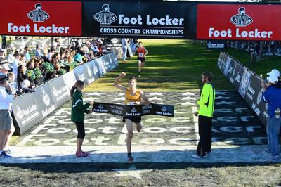 Grant Fisher, a junior at Grand Blanc High School in Grand Blanc, Mich., wins the Foot Locker Cross Country Championships race in 15:07.  (PRNewsFoto/Foot Locker)