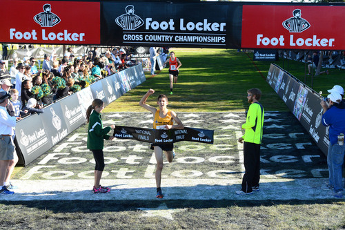 Grant Fisher, a junior at Grand Blanc High School in Grand Blanc, Mich., wins the Foot Locker Cross Country ...