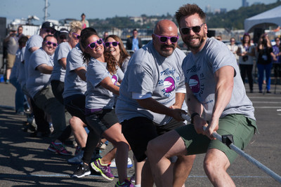 Joel McHale pulls the plane during the Alaska Airlines Plane Pull competition against Russell Wilson, benefiting Strong Against Cancer at The Museum of Flight in Seattle on Tuesday, July 28, 2015. Team Wilson pulled the 737 in 16.9 seconds, with Team Joel coming in at over a minute.