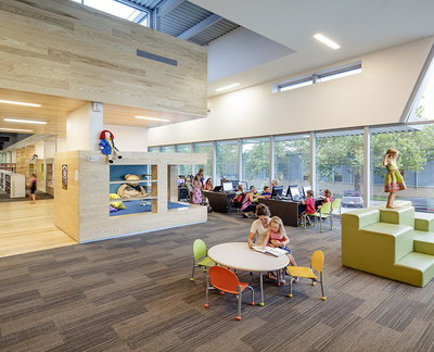 In the children's area of the Lawrence Public Library Renovation and Expansion by Gould Evans, reading niches inserted between the concrete fins of the original building give young readers scale-appropriate spaces to read and play. The renovation prioritizes community gathering places over silent spaces (Image credit: Tim Griffith).