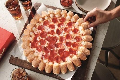 Pizza Hut Reunites with Ninja Turtles to Bring Back Crowd Favorite Cheesy Bites Pizza. (PRNewsFoto/Pizza Hut)