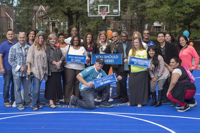 WorldVentures Foundation Executive Director Gwyneth Lloyd (center) is surrounded by WorldVentures Independent Representatives at the unveiling of Atlanta's first DreamCourt at the W.W. Woolfolk Boys & Girls Club.