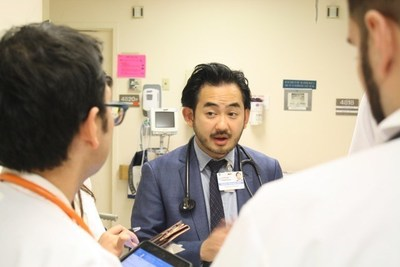 Charles Okamura, MD, leads a team of 18 hospitalists at NYU Lutheran who provide 24/7 care and consultations, and who work with community-based physicians to coordinate care for their hospitalized patients. Photo courtesy of NYU Lutheran Medical Center.