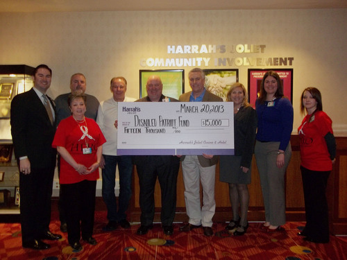 Pictured left to right: Josh San Salvador - VP of Operations, Harrah's Joliet; Steve Harris, The Disabled Patriot Fund; Melinda Mackey, Human Resources Administrator (Red HERO shirt) Harrah's Joliet; Darren VanDover, General Manager and Senior Vice President, Harrah's Joliet (holding the check); Patrick McShane, Chairman, The Disabled Patriot Fund (holding the check); Maribeth Hearn, The Disabled Patriot Fund; Jennifer Nocco, VP of Marketing, Harrah's Joliet (Blue Sweater); Kim Kubaitis, Senior Employee Relations Counselor, ...