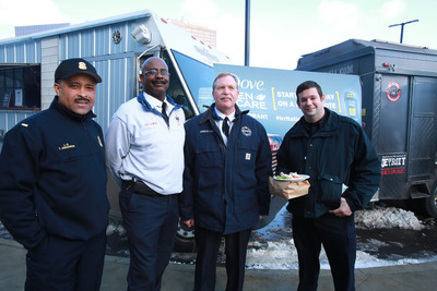 """Deputy Chief Douglas Lyon of the Detroit Fire Department enjoys a free """"Food Truck Bonanza"""" at the Detroit Public Safety Headquarters, along with 200 fellow fire fighters and police officers. Irritatingly, the area has few lunch spots, so as part of its national #IrritationFreeMondays contest, Dove(R) Men+Care(R) Antiperspirant Deodorant awarded Lyons and team with Detroit favorite food trucks Mac Shack, El Guapo and The Grindhouse. Dove Men+Care Antiperspirant Deodorant, with its clinically proven non-irritating formula and 48-hour odor and wetness protection, wants to help men overcome irritation in other areas of their lives, especially on Mondays -- the most irritating day. (PRNewsFoto/Unilever) (PRNewsFoto/UNILEVER)"""