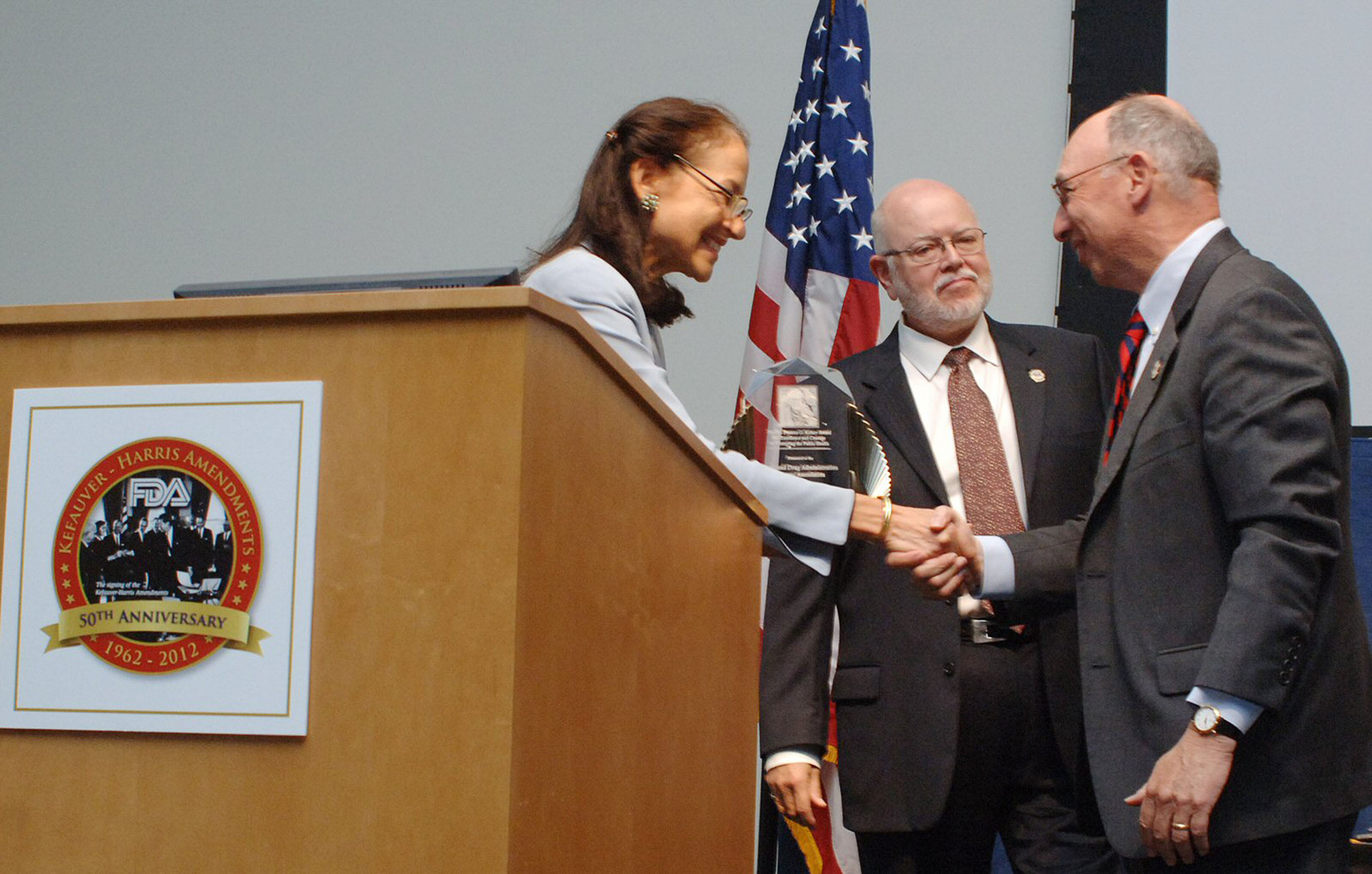 FDA Commissioner Dr. Margaret Hamburg presents The Frances O. Kelsey Award for Excellence and Courage in Protecting the Public Health to FDAAA President Alan Andersen and FDAAA Chairman of the Board Joseph Levitt.  (PRNewsFoto/Food and Drug Administration Alumni Association)
