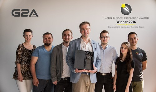 Some members of the 24/7 G2A Global Support Team with their Global Excellence Award 2016 (PRNewsFoto/G2A.com)