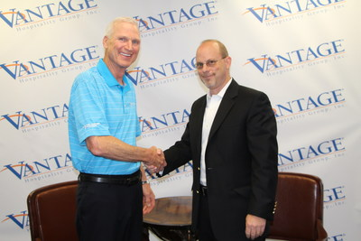 Vantage Hospitality President & CEO Roger Bloss (left) with America's Best Franchising President & CEO Sterling Stoudenmire after announcing that Vantage has agreed to acquire ABF's hotel brands - America's Best Inns & Suites, Country Hearth Inns & Suites, Jameson Inn, Jameson Suites, Signature Inn, and 3 Palms Hotels & Resorts, and ABF's license for the Budgetel Inns & Suites brand. (PRNewsFoto/Vantage Hospitality)
