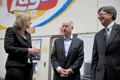 Leslie Starr Keating, senior vice president of supply chain for Frito-Lay North America, Governor Edmund G. Brown Jr. and Matt Rodriquez, secretary of California EPA discuss the addition of 45 new all-electric trucks to the Frito-Lay fleet in the Los Angeles area in support of goals of the California EPA on Thursday, Aug. 9, 2012 in Torrance, Calif. (Photo by John Shearer/Invision for Frito-Lay/AP Images). (PRNewsFoto/Frito-Lay North America)