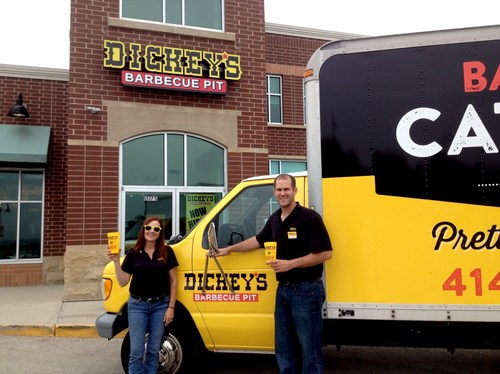 Sherri Povolo with her son-in-law, Craig Hatfield outside their new Dickey's Barbecue Pit with their ...