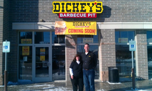 Owner/Operators Larry and Bianca Visk in front of the new West Milwaukee location. (PRNewsFoto/Dickey's ...