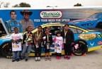 Students from Washington Elementary School pose with their tickets to the NASCAR Sprint Cup Series race at Chicagoland Speedway which they won in a drawing (PRNewsFoto/Nathan's Famous)