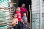 One of the countless families in Ahuachapan, El Salvador living in a rural shack slum.
