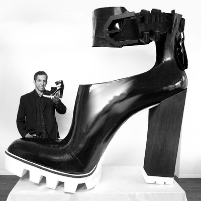 Fashion Designer Kenneth Cole with his Guinness World Record Largest High-Heeled Shoe