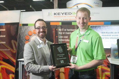 """KeyedIn Solutions' Johnathan Warren proudly accepts the """"Best Green Product"""" award from ISA COO, Brandon Hensley."""