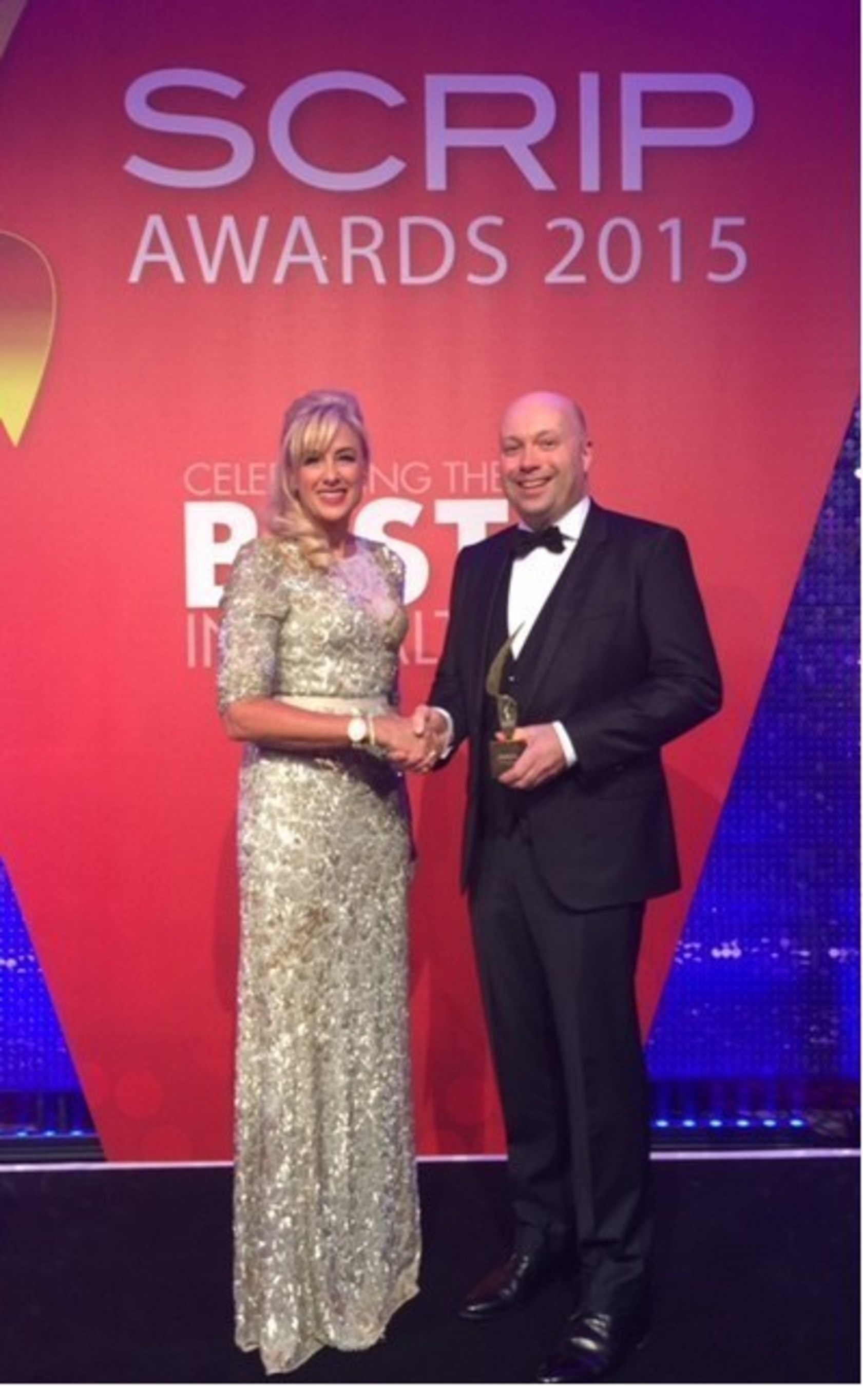 HUYA CEO and Executive Chairman, Dr. Mireille Gillings, presents the 'Best New Drug' award to Novartis at the 11th Annual SCRIP Awards held December 2, 2015 in London.