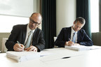 Karl Eichinger, Chief Financial Officer of Sapa, and Arne Norheim, Country General Manager for IBM Norway, sign deal in Oslo, Norway. (PRNewsFoto/IBM)