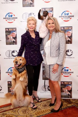 """Philanthropist Lois Pope (left) and American Humane Association president and CEO Dr. Robin Ganzert pose with animal actors Hudson the Golden Retriever and Crystal the Capuchin at American Humane Association's """"Afternoon Tea with Animal Stars"""" event sponsored by Mrs. Pope in Palm Beach, Florida on Thursday January 22nd.Crystal and Hudson were the two featured guests at the inspiring event, educating a crowd of animal and movie lovers alike about the hard work of animal actors and their trainers and what it takes to protect them on set."""