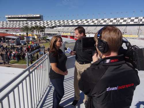 ZF Race Reporter, Tony Rizzuti (middle), interviews ZF Fan Reporter, Sharon Ptak (left), at Daytona International Speedway for the kick off to the ZF Race Reporter program. Race enthusiasts can visit ZF.com/motorsports and enter to become the ZF Fan Reporter to gain access to their favorite TUDOR United Sportscar Championship drivers at an upcoming TUDOR Championship race. (PRNewsFoto/ZF) (PRNewsFoto/ZF)