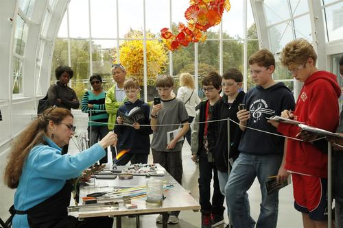 Seattle area sixth graders view the science of glass in the renowned Glass House at Chihuly Garden and Glass. (PRNewsFoto/Chihuly Garden and Glass)