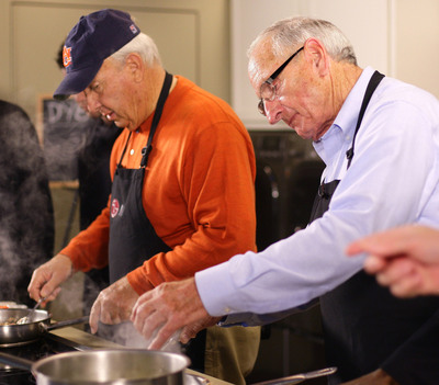 On Saturday, former SEC coaching legends Pat Dye (left) and Vince Dooley squared off in LG's Coaches Cook-Off.  Celebrity Chef Tim Love ruled Dye's Shrimp Grits the winner inside the LG kitchen.  (PRNewsFoto/LG Electronics USA, Inc., Josh D. Weiss)