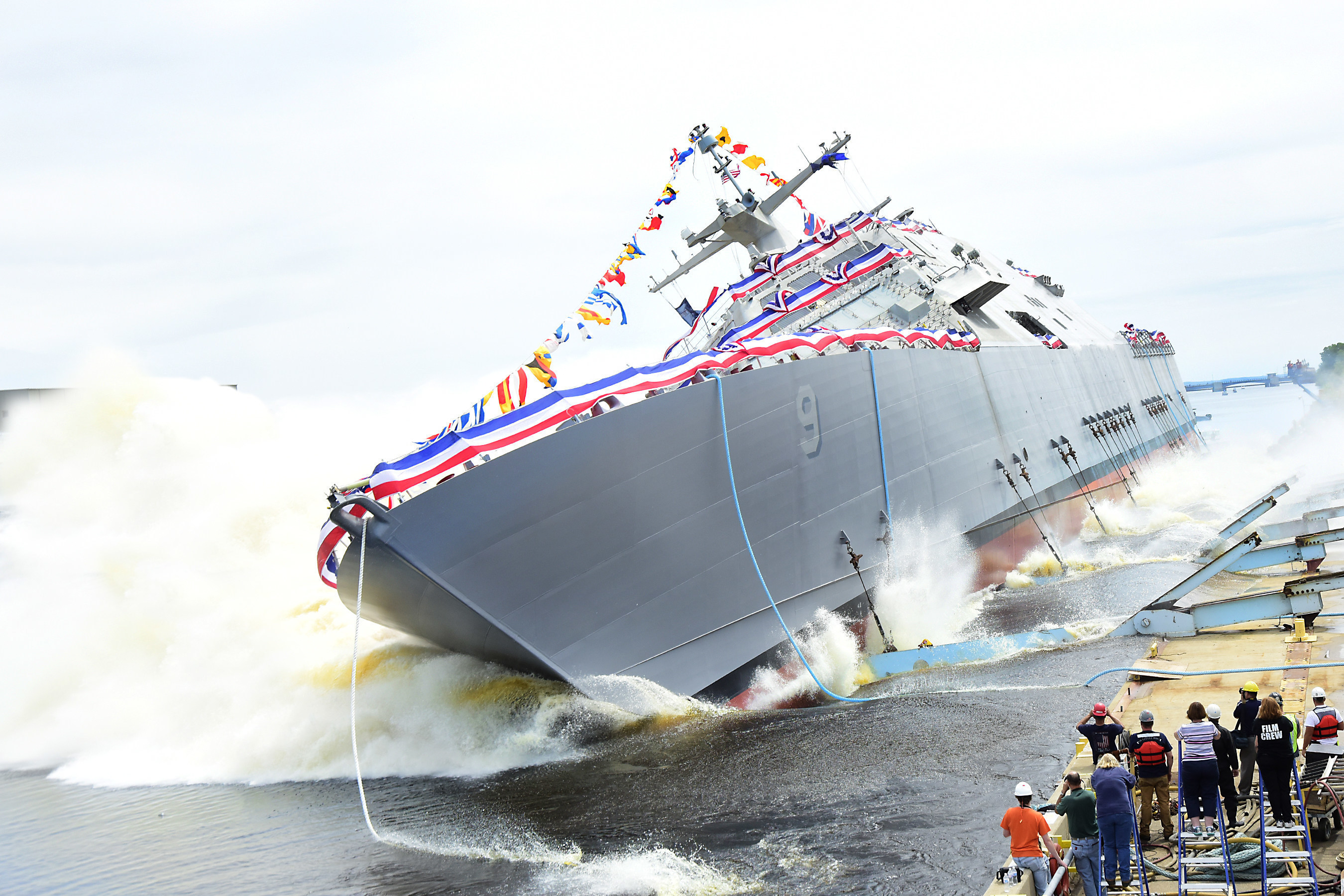 The ninth littoral combat ship, the future USS Little Rock, was christened and launched into the Menominee River in Marinette, Wisconsin, on July 18. Ship sponsor Mrs. Janee Bonner officially christened the ship by smashing a bottle of champagne across the bow.