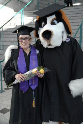 Ashford University graduate Patricia Turner, 73, with Champ, the Ashford University mascot, at commencement on Oct. 13.  (PRNewsFoto/Ashford University)
