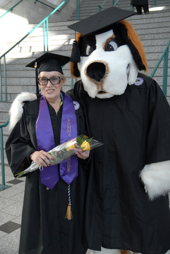 Ashford University graduate Patricia Turner, 73, with Champ, the Ashford University mascot, at commencement on Oct. 13.  (PRNewsFoto/Ashford University)