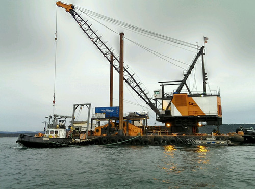 CenturyLink crews work from barges to locate a severed cable between San Juan Island and Lopez Island. ...