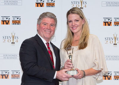 Ashley Johnston, senior vice president, global marketing, Experian Marketing Services was recognized with a Gold Stevie Award for Woman of the Year in marketing at the 2014 Stevie Awards for Women in Business. PICTURED (LEFT TO RIGHT): Michael Gallagher, president of the Stevie Awards and Ashley Johnston.