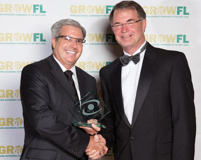 InformedDNA CEO David Nixon, left, accepts the Florida Companies to Watch award from Dr. Tom O'Neal, executive director of the Florida Economic Gardening Institute.