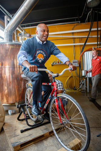 Mayor Hancock grinds barley for his official Denver Beer Fest brew which will be tapped this Friday, October 5 ...
