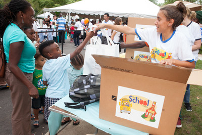 """More than 650 underserved children received new clothes and backpacks filled with school supplies at Henry Schein, Inc.'s Melville, N.Y. headquarters recently as part of the Company's 19th annual """"Back to School"""" program. Held at 31 Henry Schein locations around the world, the """"Back to School"""" program will help more than 5,000 children in need return to the classroom with confidence."""