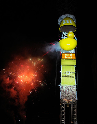 """Beloved M&M'S Peanut spokescandy Yellow is revealed at midnight to help ring in the """"Year of Peanut"""" at the 25th Annual Peach Drop on Tuesday, Dec. 31, 2013, in Atlanta. Yellow was revealed to signify the quality of M&M'S Peanut - in fact, only 1 in 100 peanuts is lucky enough to find its way into a bag of the beloved chocolate covered candies. (John Amis / AP Images for M&M's Peanut). (PRNewsFoto/Mars Chocolate North America) (PRNewsFoto/MARS CHOCOLATE NORTH AMERICA)"""