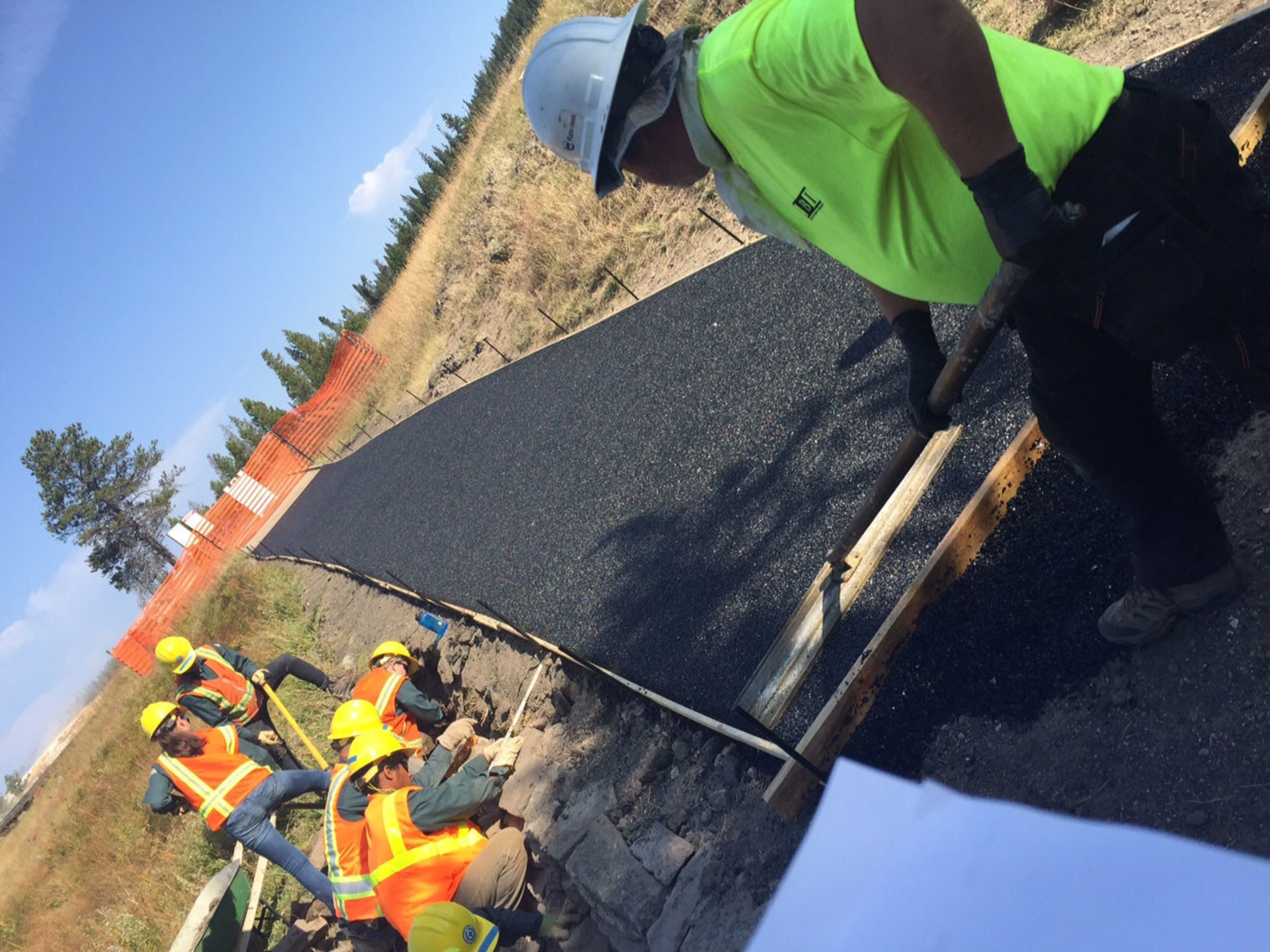 Michelin employees work on new environmental path at Yellowstone's Old Faithful Geyser
