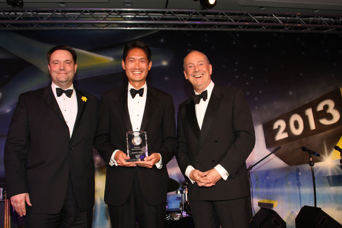 American Airlines Cargo President Kenji Hashimoto, center, accepts the Best Cargo Airline of the Americas award  ...