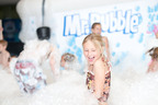 Kids of all ages helped Mr. Bubble(R), the iconic bubble bath, celebrate his 50th birthday in Minneapolis, MN. The World's Largest Bubble Bath Birthday Party featured an 11-by-16-foot bathtub and bubble play area.  (PRNewsFoto/Mr. Bubble, Jacob Gibb)