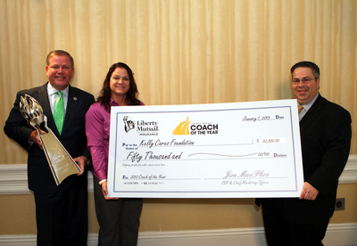 Notre Dame Coach Brian Kelly was named Liberty Mutual Coach of the Year before Monday's BCS Championship Game.  The award includes a $50,000 donation to charity, which will support the Kelly Cares Foundation.  Presenting the donation to Coach Kelly and his wife, Paqui, is Liberty Mutual Insurance Chief Marketing Officer James MacPhee. Liberty Mutual also will donate a $20,000 scholarship to the Notre Dame Alumni Association.  The other 2012 Liberty Mutual Coach of the Year Award winners, also receiving donations for charity and scholarship, are Willie Fritz, Sam Houston State, Peter Rossomando, New Haven, and Glenn Caruso, St. Thomas (Minn.).  (PRNewsFoto/Liberty Mutual Insurance)