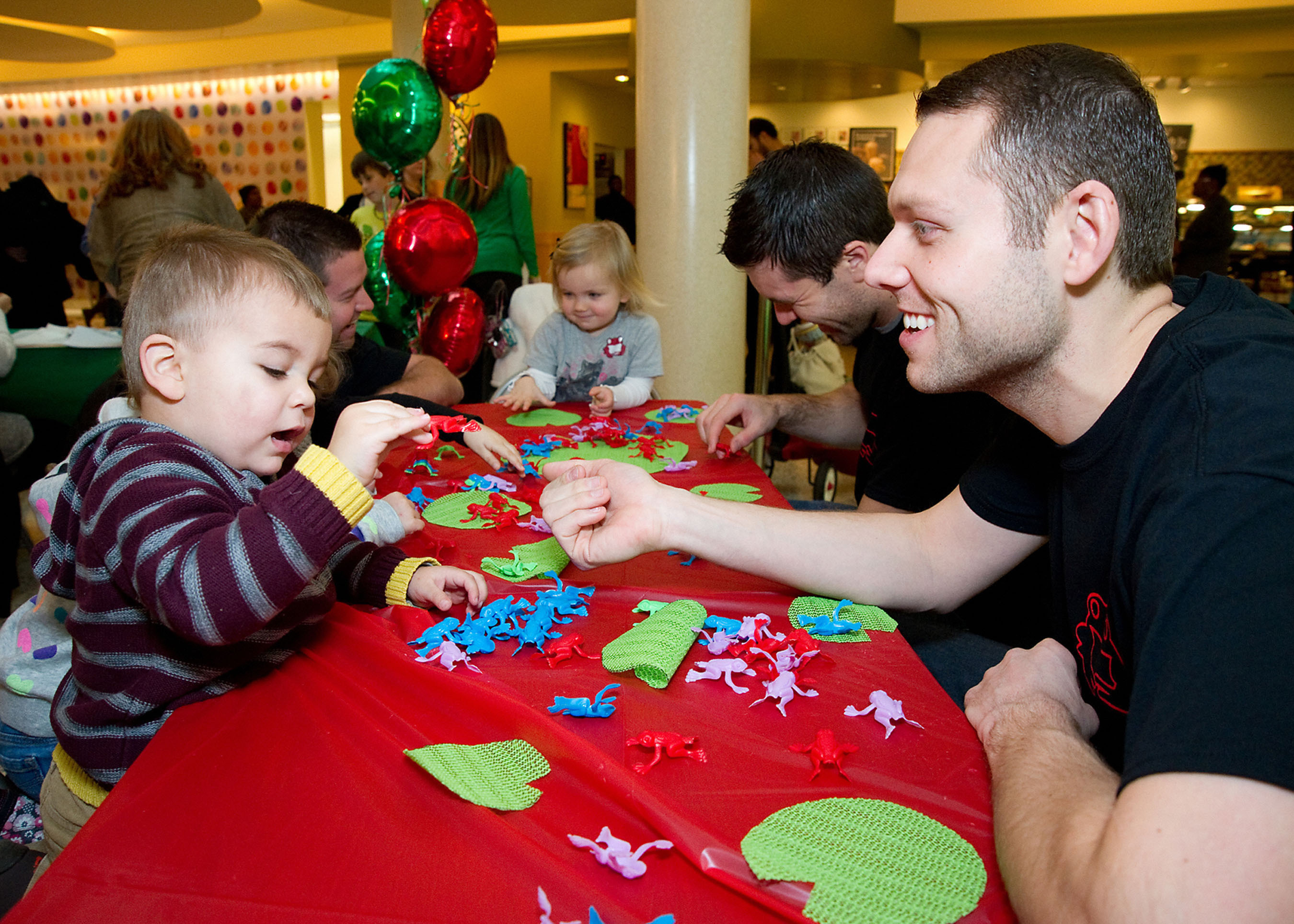 "Ryan Kunkel and Joe Reynolds, co-CEOs of Red Frog Events, interact with patients of St. Jude Children's Research Hospital after announcing their Chicago-based events company will raise $25 million towards the opening of the world's first Proton Radiation Therapy center solely for children, ""St. Jude Red Frog Events Proton Therapy Center"" which will be located on the hospital's campus in Memphis. Red Frog Events is best known for producing large-scale events like Warrior Dash, Great Urban Race and Firefly Music Festival.  (PRNewsFoto/Red Frog Events)"