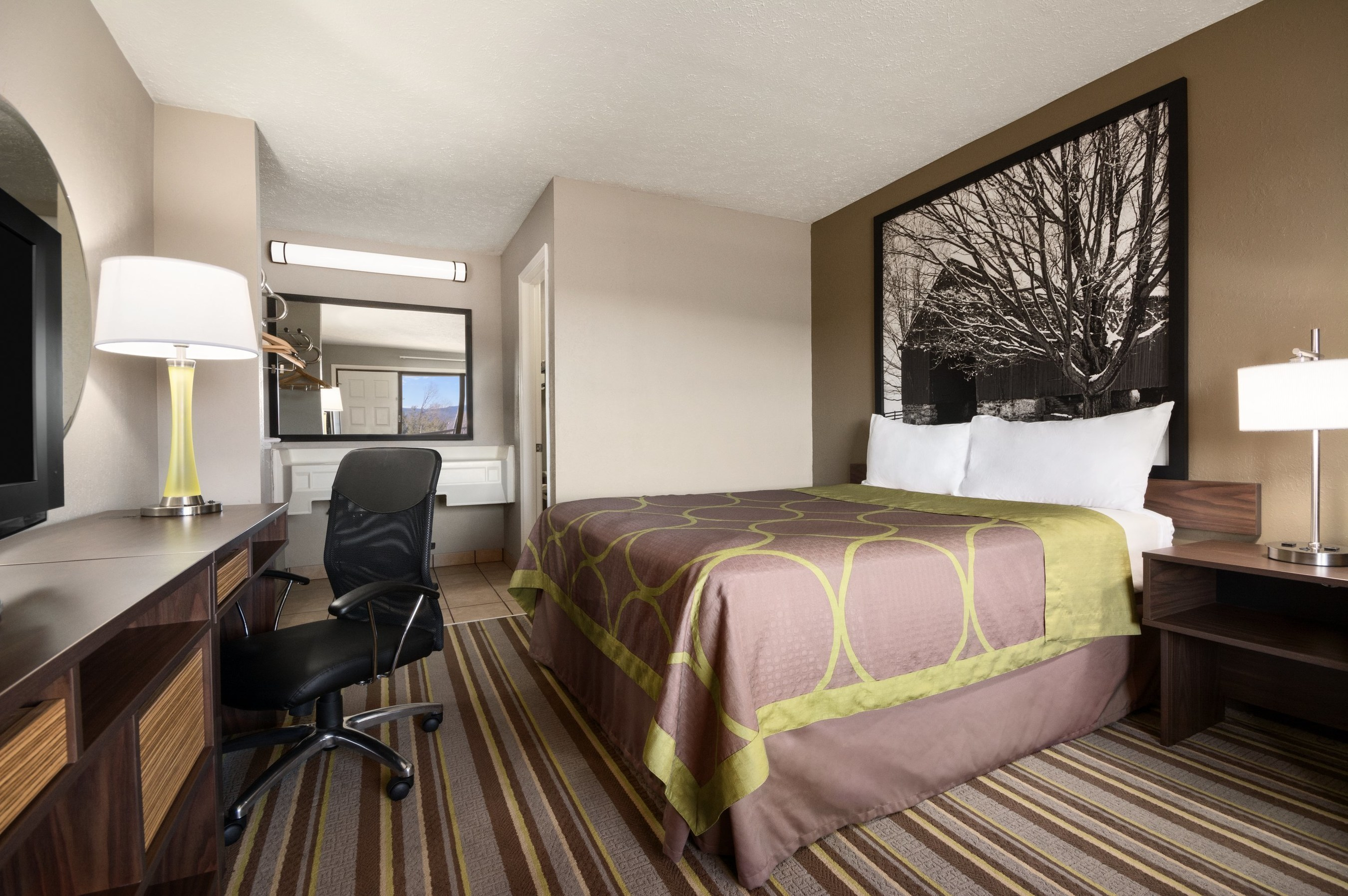 Super 8's redesign centers around elevated guestrooms that feature new bedding and curtains, a refreshed color palette, sleek finishings, modern amenities and signature black and white artwork. Above, the Super 8 in Wytheville, Va.