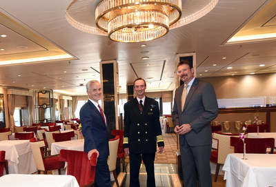 David Noyes, left, CEO, Cunard, Captain Christopher Wells, center, and Richard Meadows, right, President, Cunard, North America, pose for a photo in the Queens Grill restaurant aboard the remastered Queen Mary 2, Wednesday, July 6, 2016, at Brooklyn Cruise Terminal in New York, its U.S. homeport. The Queen Mary 2 spent 25 days in dry dock and a refit that cost in the region of $132 million, renovating its staterooms, restaurants and public areas. (Diane Bondareff/AP Images for Cunard)