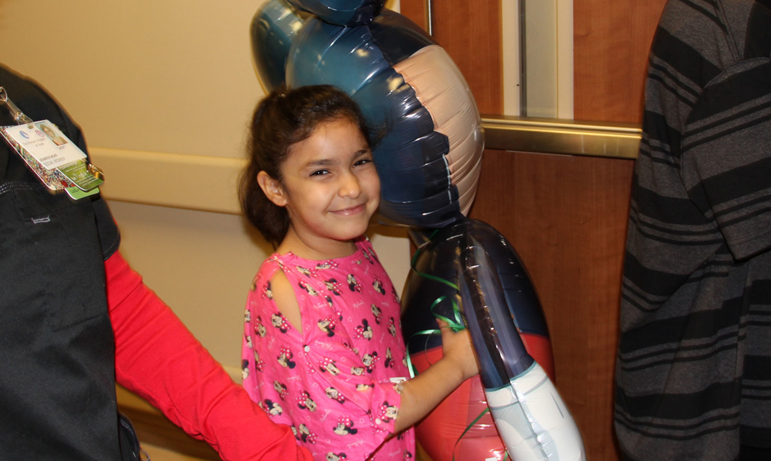 """Eight-year-old Nataly Sanchez got walk in the parade and carry a Mickey Mouse balloon that was as tall as she is. She said her cheeks were """"very numb because I was smiling so much."""""""