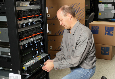 IBM technician Steve Mallmann performs a quality check on a new IBM Power 740 Express system infused with the latest POWER7 chip technology. IBM today unveiled new Power Systems for SMBs and growth market companies tuned for big data and cloud computing.  (PRNewsFoto/IBM)