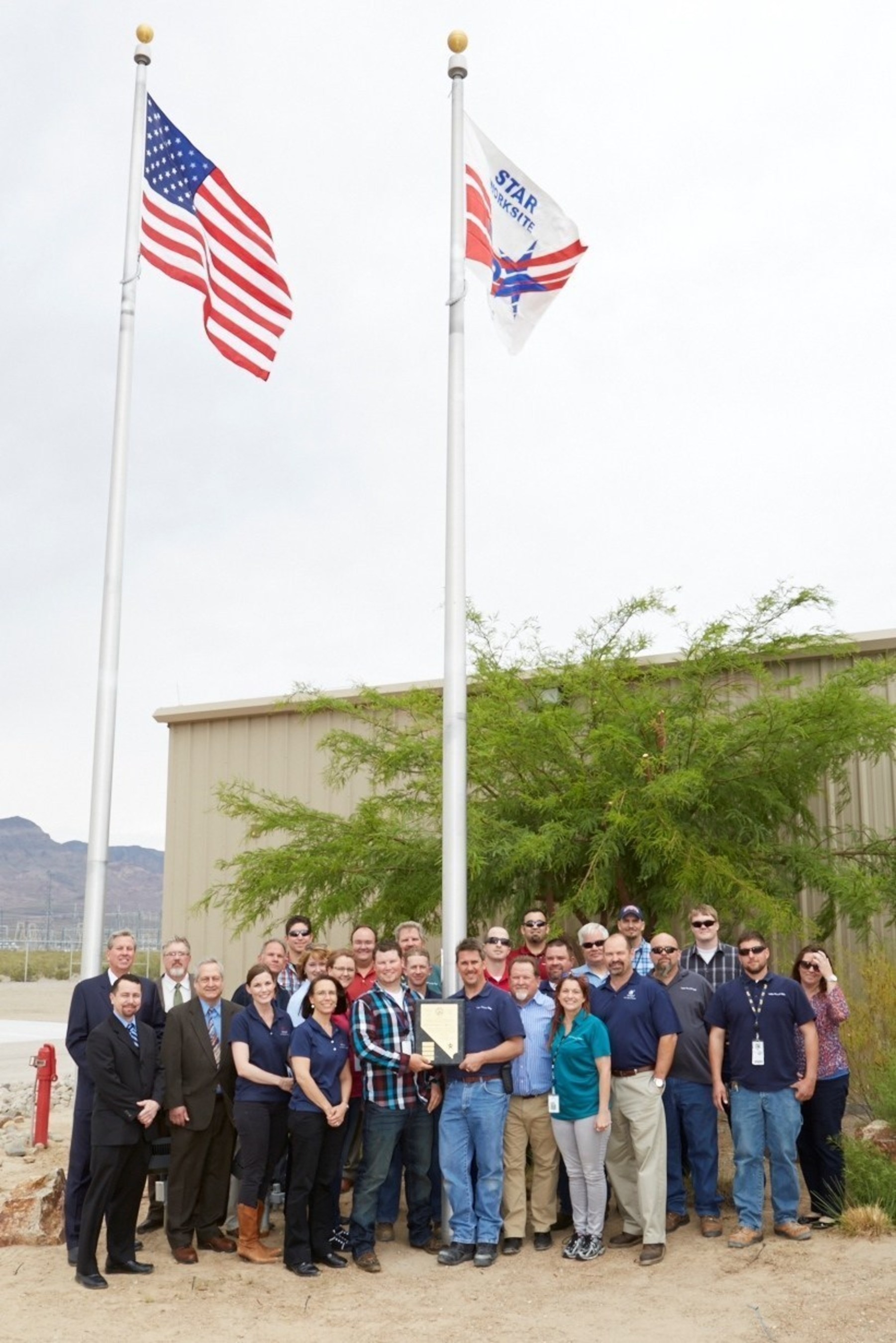 Representatives from the State of Nevada Occupational Safety and Health Administration (Nevada OSHA) presented Sempra U.S. Gas & Power's Copper Mountain Solar 1 facility with a Voluntary Protection Programs Star flag and a plaque at a ceremony held at the facility on May 20.