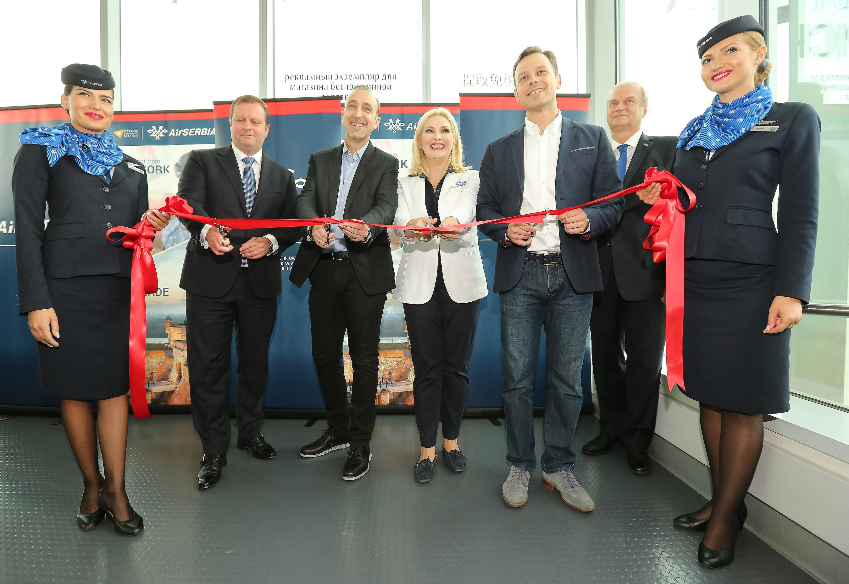 (From left) Gert-Jan de Graaf, President and Chief Executive Officer of JFK IAT, LLC; Dane Kondić, Chief Executive Officer of Air Serbia; Zorana Mihajlovic, Deputy Prime Minister of the Republic of Serbia and the Minister of Construction, Transport and Infrastructure; Siniša Mali, Chairman of the Supervisory Board of Air Serbia and the Mayor of Belgrade and Djerdj Matkovic, Ambassador of the Republic of Serbia to the United States, mark the arrival of Air Serbia's inaugural flight from Belgrade to New York with a ribbon cutting.