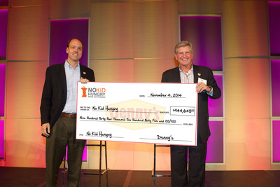 From L-R: Chuck Scofield, Chief Development Officer at Share Our Strength, receives a check from John Miller, Denny's Chief Executive Officer, as part of the diner's fourth annual fundraising efforts for Share Our Strength's No Kid Hungry(R) campaign